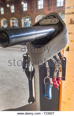 Deluxe repair station for bicycles and bikes  on the platform at Bristol Temple Meads Railway Station, England, UK - Stock Image