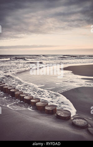 Empty beach at sunrise, color toned picture. - Stock Image