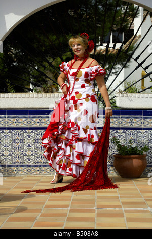 Beautiful blond middle aged Spanish woman in traditional costume - Stock Image