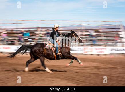 USA, Arizona, Buckeye, Hellzapoppin Arena. Barrel racing at rodeo. Credit as: Wendy Kaveney / Jaynes Gallery / DanitaDelimont.com - Stock Image