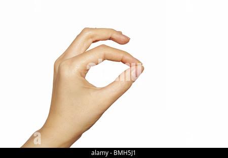 Pinching hand isolated - Stock Image