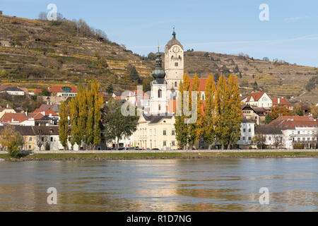 Twin churches reflecting in the River Danube at Stein an der Donau, a popular tourist town next to the river Danube and a UNESCO World Heritage Site - Stock Image