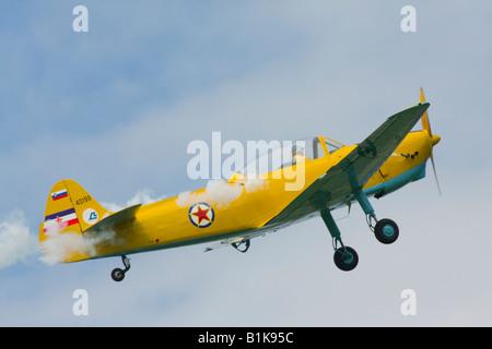 Yellow Aero-3 simulating engine trouble and spurting smoke, Airshow Maribor 2008, Slovenia June 15, 2008 - Stock Image