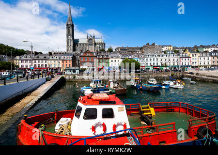 St. Colemans cathedral and Cobh harbour in County Cork - Stock Image
