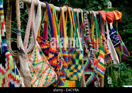 A selection of colourful hand made bags called bilums on display in Papua New Guinea - Stock Image