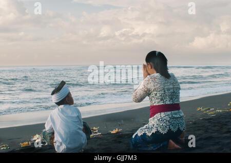 Praying in Bali - Stock Image