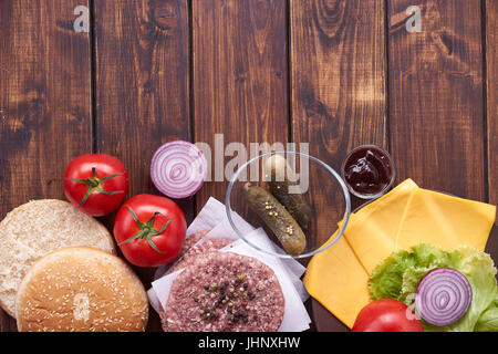 Top view of raw cheeseburger ingredients - Stock Image