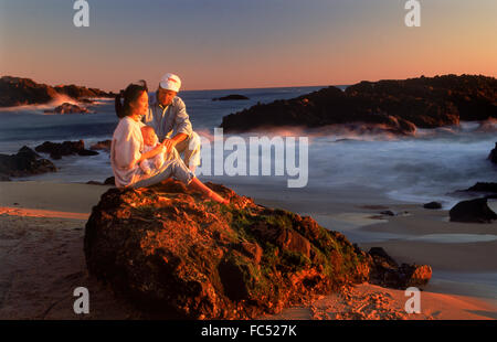 Family of three at sunset in Laguna Beach California USA - Stock Image
