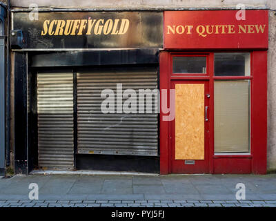 Two small retail shops closed down and disused in former mining town Bishop Auckland Durham, England UK - Stock Image