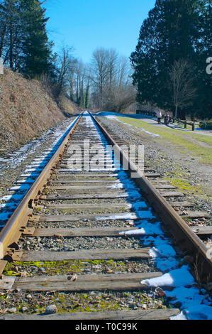Railway track leading into the horizon. - Stock Image