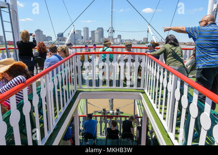 Look! Tourists on the steamboat Natchez exploring New Orleans and the Mississippi. - Stock Image