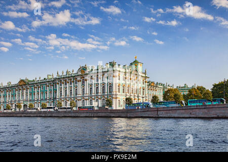 19 September 2018: St Petersburg, Russia - Winter Palace and State Hermitage Museum, with a long line of tour coaches outside. - Stock Image