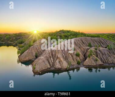 Konduki, Tula region, Russia. Aerial view of abandoned quarry turned into picturesque hills and blue lakes called Ushakovskiye Karyery - Stock Image