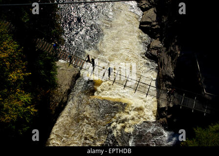 Pedestrian suspension bridge over river gorge waterfall Canyon Ste Anne Park - Stock Image