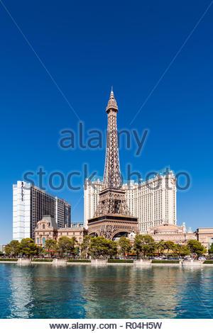 Bellagio fountains and replica of Eiffel Tower at Paris Casino, Las Vegas - Stock Image
