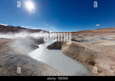 Steam rises from bubbling mud at the Sol de la Manana geyser field in Bolivia - Stock Image