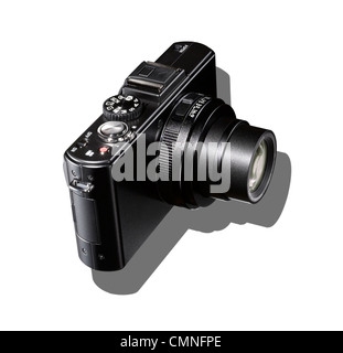 A black camera with shadow on a white background. - Stock Image