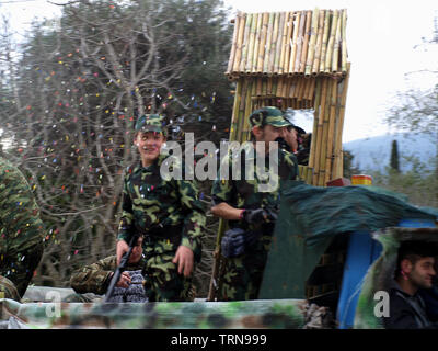 Army float from Nymfes carnival making it's way through Xanthates to Roda, Corfu, Greece - Stock Image