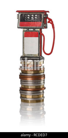 A red toy petrol pump sitting on a pile of coins - Stock Image