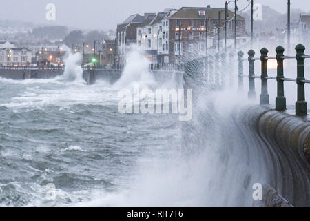 Penzance, Cornwall, UK. 8th Feb 2019. UK Weather. Storm Erik batters the sea front at Penzance with winds gusting above 60  mph and heavy rain. Credit: Simon Maycock/Alamy Live News - Stock Image