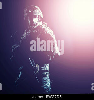Soldier hiding his identity with balaclava and sunglasses in blinding light. - Stock Image
