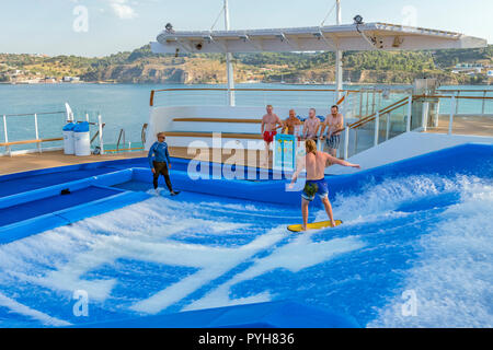 Young man flow surfing / flowriding aboard the Independence of the seas cruise ship - Stock Image