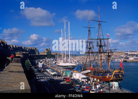 Old schooners and sailboats moored in the port at St-Malo in Brittany, France - Stock Image