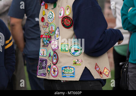 Women wearing a vest with Girl Scouts patches on it. - Stock Image
