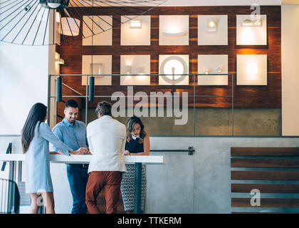 High angle view of business people discussing in office - Stock Image