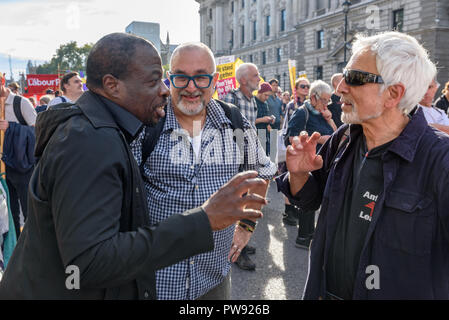London, UK. 13th October 2018.  Weyman Bennett, David Rosenberg and Glyn Secker talk together in the crowd at  the rally in London to oppose racism  and fascism close to where the racist, Islamophobic DFLA were ending their march on Whitehall bringing together various groups to stand in solidarity with the communities the DFLA attacks. The event was organised by Stand Up To Racism and Unite Against Fascism. Peter Marshall/Alamy Live News - Stock Image