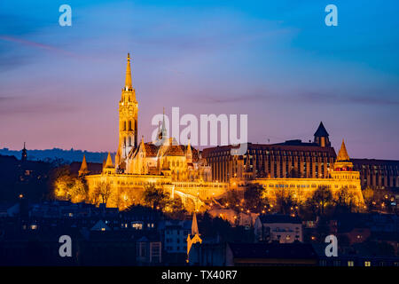 Night view of the Matthias Church and River Danube bank at Budapest, Hungary - Stock Image