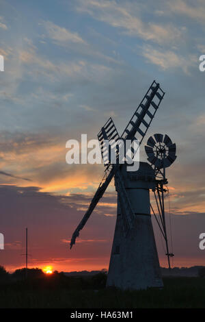 The white painted Thurne Mill on the River Thurne, Norfolk Broads at sunset. - Stock Image