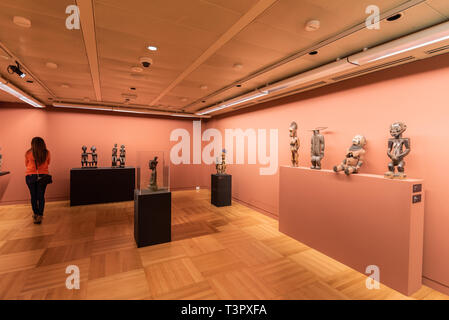 Tenerife Spain - February 8 2019 : Tourist visiting Traditional wooden African tribal masks at itinerant African exhibition . - Stock Image