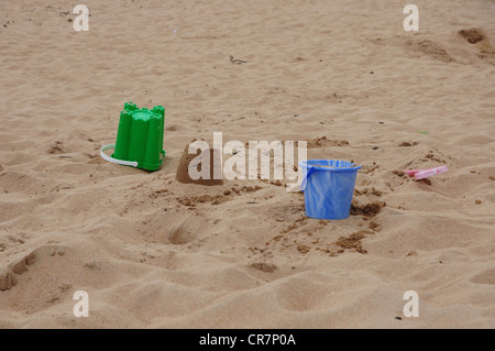 Buckets and spades on the beach at Elie, Fife - Stock Image
