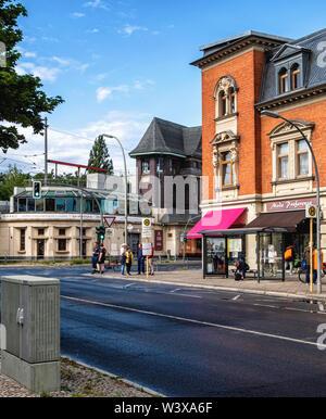 Historic old buildings  on corner of Oberhofer Weg & Kranoldplatz in Lichterfelde-Berlin. Old station signal tower & red brick apartment & shop buildi - Stock Image