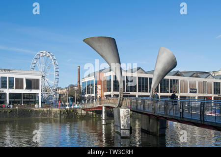 The Floating Harbour at Bristol on a sunny blue sky winter day showing moored boats and people in this bustling west country city. - Stock Image