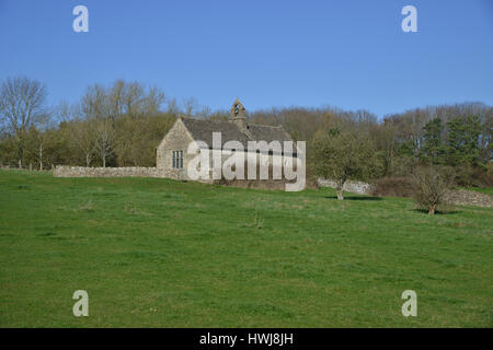 St Oswald's Church, which is of mainly 13th century origin lies in the Windrush valley near the Cotswold gateway - Stock Image