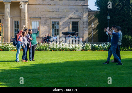 A group of Asian tourists taking selfie photographs, Museum Gardens, York, England - Stock Image