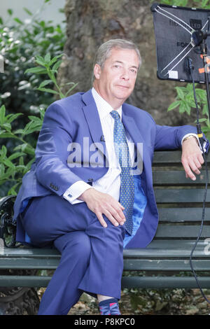 London, 12th July 2018. Former UKIP Leader Nigel Farage is seen being interviewed near the Houses of Parliament in Westminster, London today, on the day the governemtn whitepaper is published and Donald Trump visits London. Credit: Imageplotter News and Sports/Alamy Live News - Stock Image