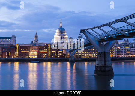 London Millennium bridge at night with St Pauls cathedral in background - Stock Image