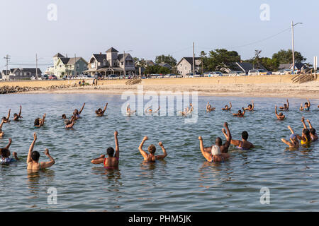 The 'Polar Bears' gather for a morning swim, exercise, and prayer in the water off Inkwell Beach in Oak Bluffs, Massachusetts on Martha's Vineyard. - Stock Image