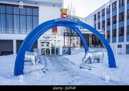 Ornamental arch and polar bears at the entrance to the town hall of Hammerfest, Finnmark County, northern Norway. - Stock Image