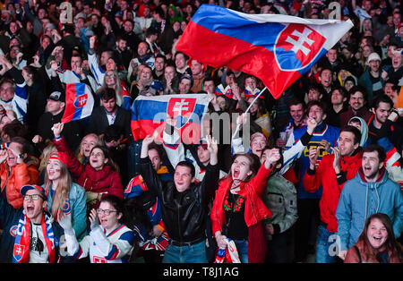 Bratislava, Slovakia. 13th May, 2019. Slovak fans cheer during the Ice Hockey World Championships group A match between Slovakia and Canada at the Fan zone in Bratislava, Slovakia, May 13, 2019. Credit: Vit Simanek/CTK Photo/Alamy Live News - Stock Image