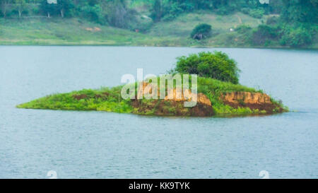 Small island in the middle of the lake in the woods - Stock Image