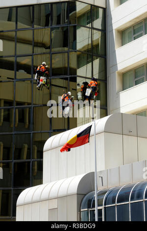 Riggers maintaining windows on high rise building, Perth, Western Australia - Stock Image