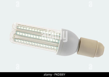 Led lamp in on position with  glass bulb and E27 socket. White background. - Stock Image