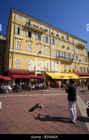 France French Reviera Nice Cours de Saleya Les Ponchettes street Cafe street musician - Stock Image