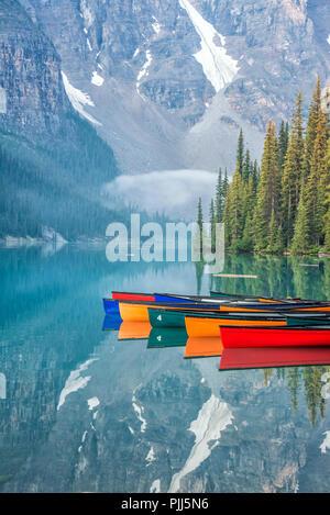 Boats Reflections on Water, Moraine Lake, Alberta, Canada - Stock Image