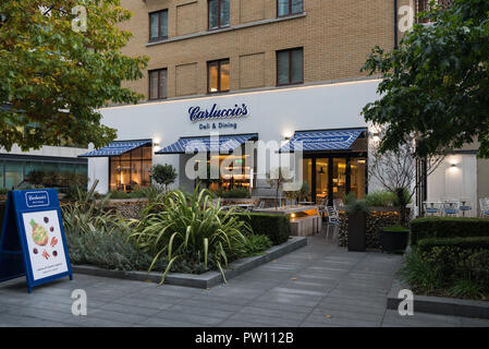 The front facade and outdoor dining area at Carluccio's Italian restaurant in Spital Square, Spitalfields Market, London, England - Stock Image