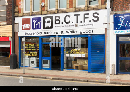 Bolton Community Transport and Furniture Services (BCTFS) charity furniture shop in Farnworth, - Stock Image